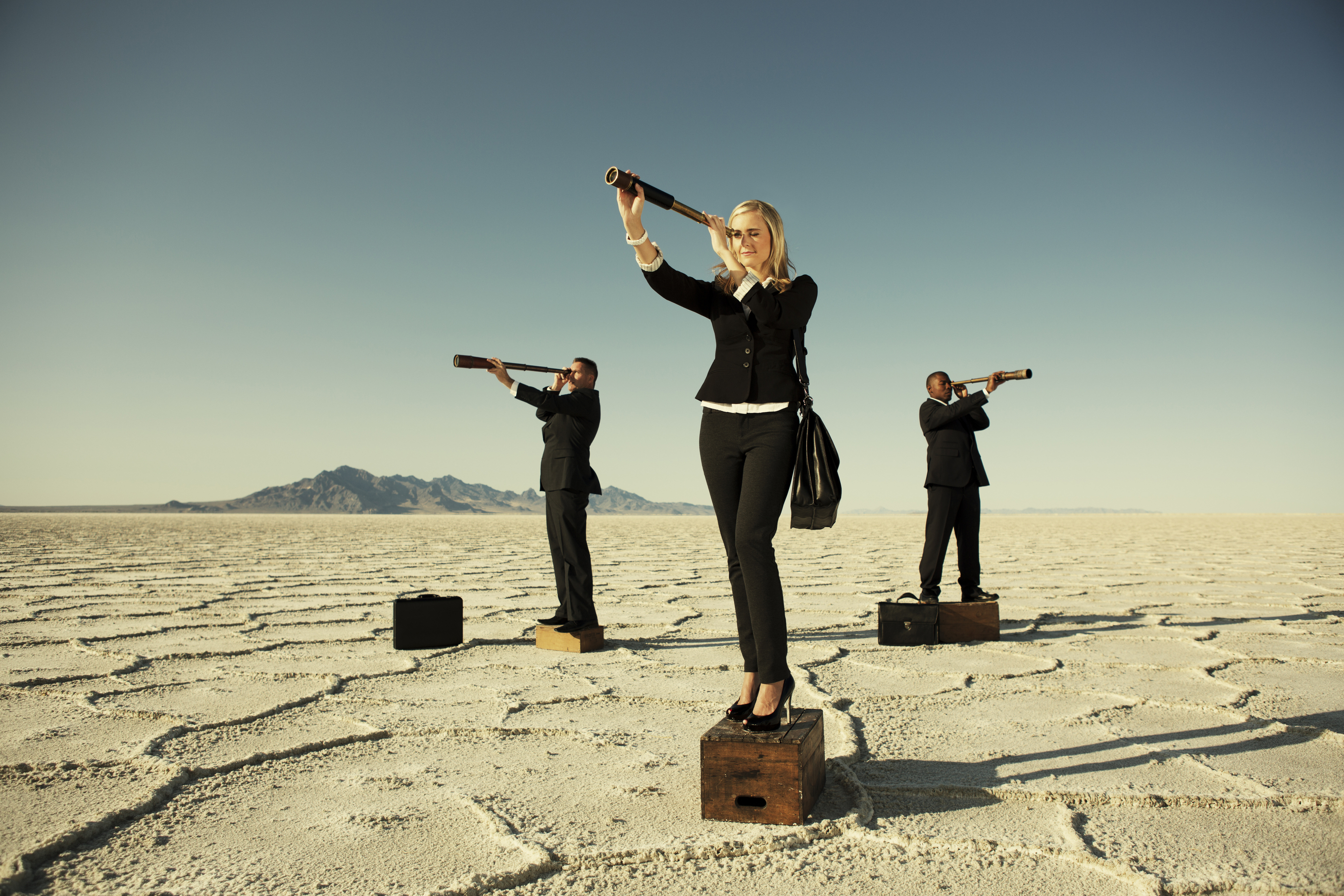A businesswoman leads her team in finding future prosperity.